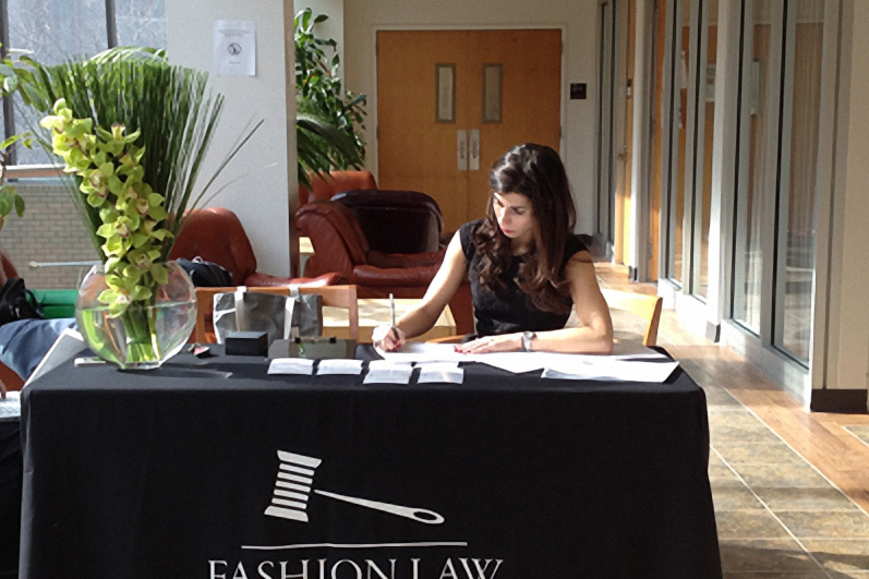 Fordham Law student - now alum! - Adrienne Montes welcoming Fashion Law Pop-Up clinic attendees